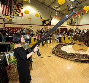 Special thanks to photographer Paul Haring who captured this shot of my auction floor team member showcasing the potato cannon.