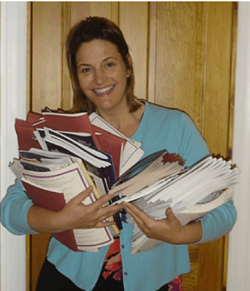 Sherry Truhlar with Auction Catalogs