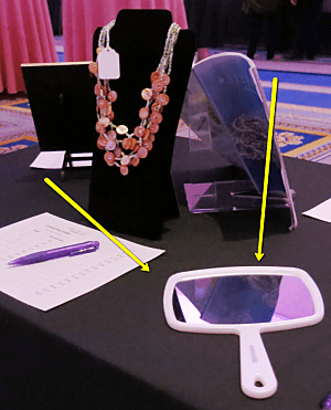 Silent auction display ideas for necklace using mirror