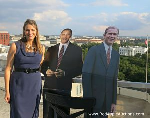 D.C> Benefit Auctioneer Sherry Truhlar stands with White House behind her