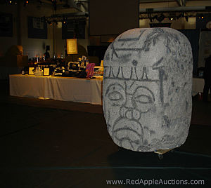 Some props came from a prop house, such as this (Styrofoam) Easter Island stone head. But other props - like those in the centerpieces - were pulled from the homes of parents.