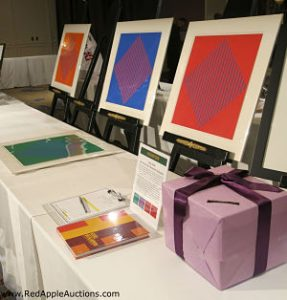 These four related art pieces were sold via sealed bid.