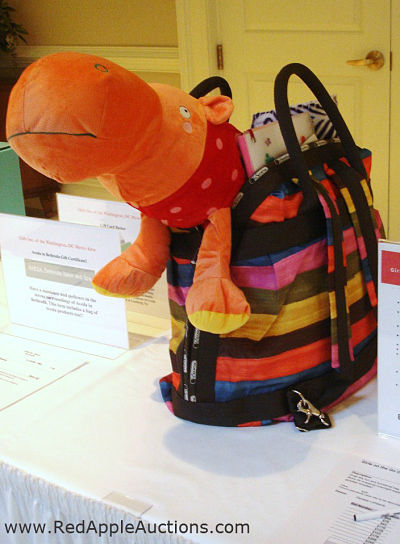 Orange plush hippo in silent auction basket