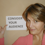 Sherry Truhlar with Consider Your Audience sign