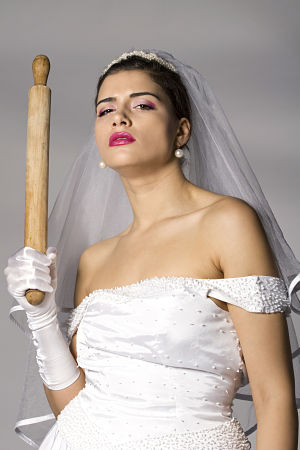 Stressed out bride with rolling pin