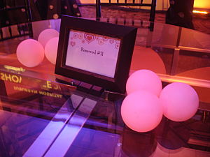 "These battery-operated lights on this gala table emitted a ""Radiant Orchid"" hue."