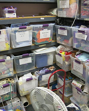 how to organize a charity auction - LATM closet with craft supplies