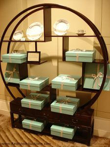 Live auction item display Tiffany dishes