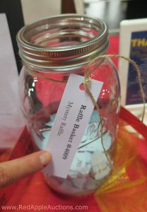 new idea for silent auctions. Surprise Box in bucket raffle