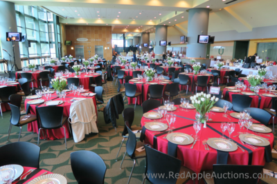 Diana Vreeland-inspired auction luncheon with red tablecloths