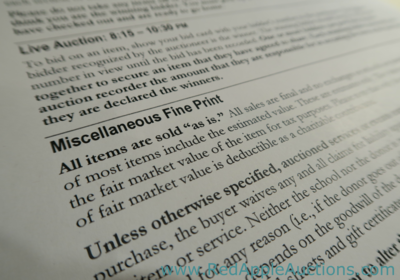 Fundraising Auction rules presented as fine print